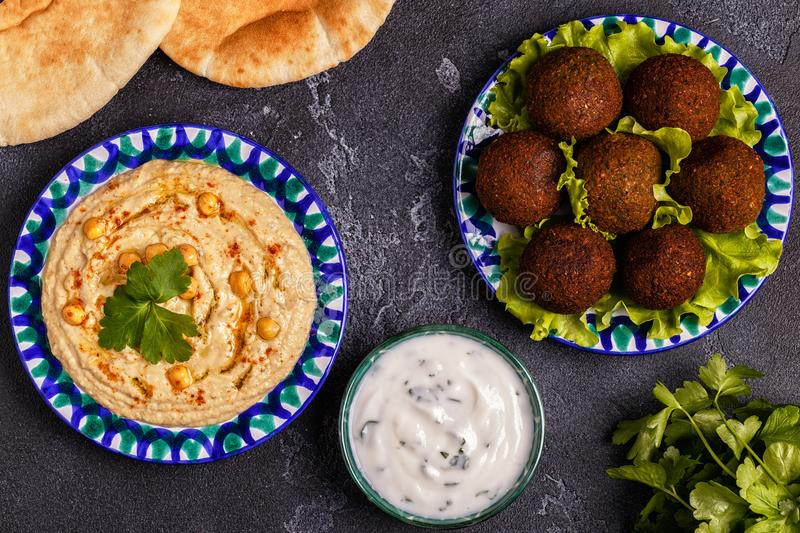 Classic falafel and hummus on the plates. royalty free stock images