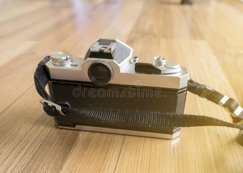 A film camera showing back panel and View Finder with wooden floor background stock images