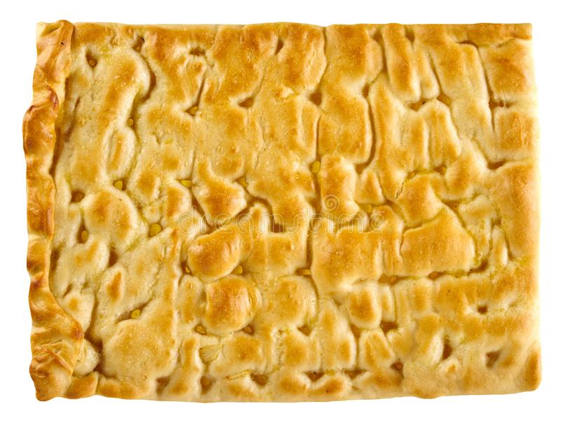 Classic focaccia bread to serve as accompaniment. Classic focaccia bread to serve as an accompaniment to Italian cuisine in a rectangular portion viewed close up royalty free stock photos
