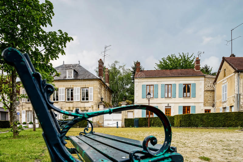Classic french bench on the street of a little village stock images