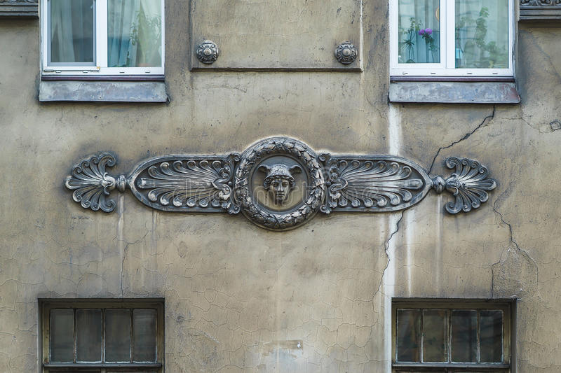 Classic fretwork on the wall of the building.  stock image