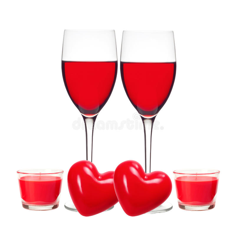 Classic Glass of Red Wine, red hearts and candles isolated royalty free stock photos