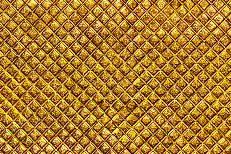 Abstract background texture of an old natural luxury, gold modern style leather with rhombs. stock image