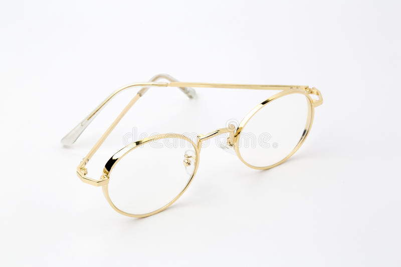 Classic gold round glasses on white background. royalty free stock images