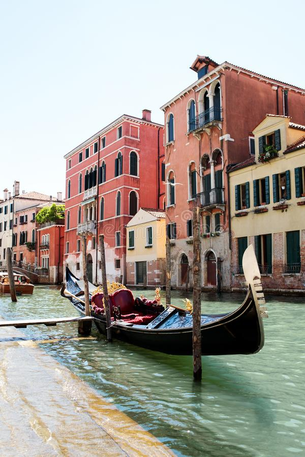 Gondola in colorful Venice Italy. Classic Gondola in canal with colorful buildings in Venice, Italy royalty free stock image