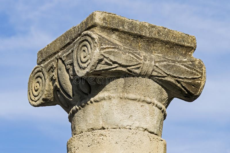 Classic Greek Style Ionic Capital at Ancient Katzrin in Israel. Closeup of a classic greek ionic capital at the talmudic era archaeological site in Katzrin in stock photo