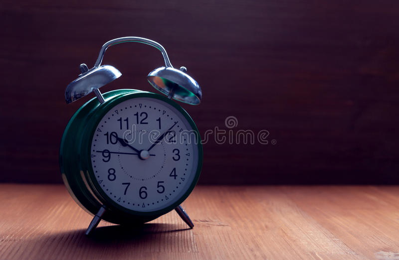 Classic green alarm clock night slip time stock photo