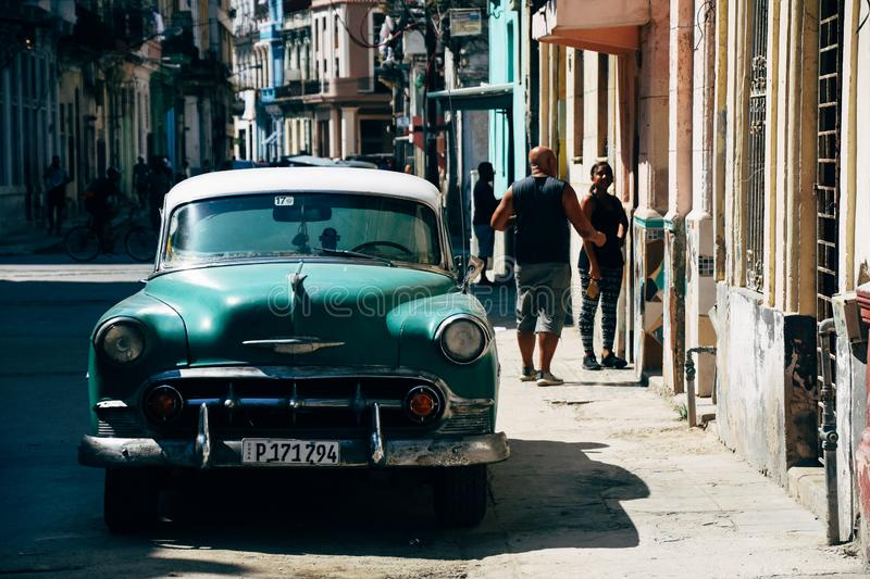 A classic green car parked on the road in Havana, Cuba. A classic beautiful green car parked on the road in Havana, Cuba royalty free stock images