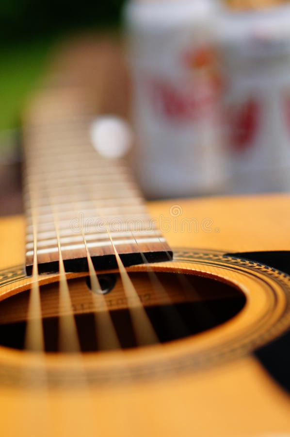 Classic guitar. Close-up of a wooden classic accoustic guitar stock photo