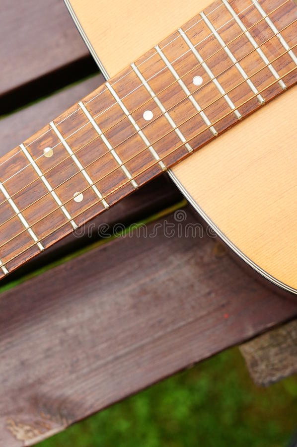 Classic guitar. Close-up of a wooden classic accoustic guitar stock photography