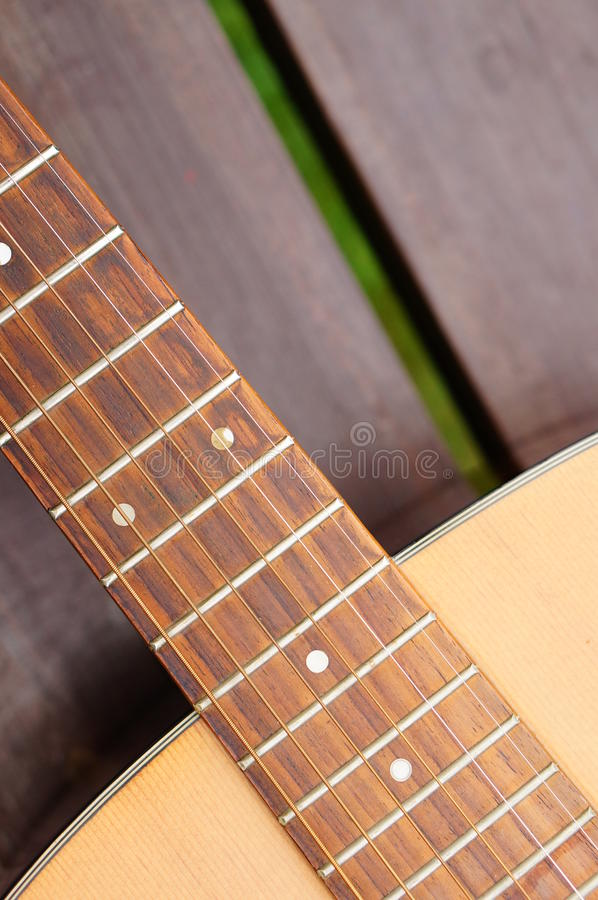 Classic guitar. Close-up of a wooden classic accoustic guitar royalty free stock photography