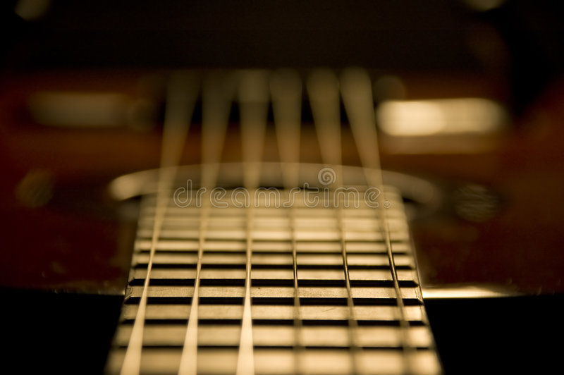 Classic guitar detail. Six string fingerboard royalty free stock images