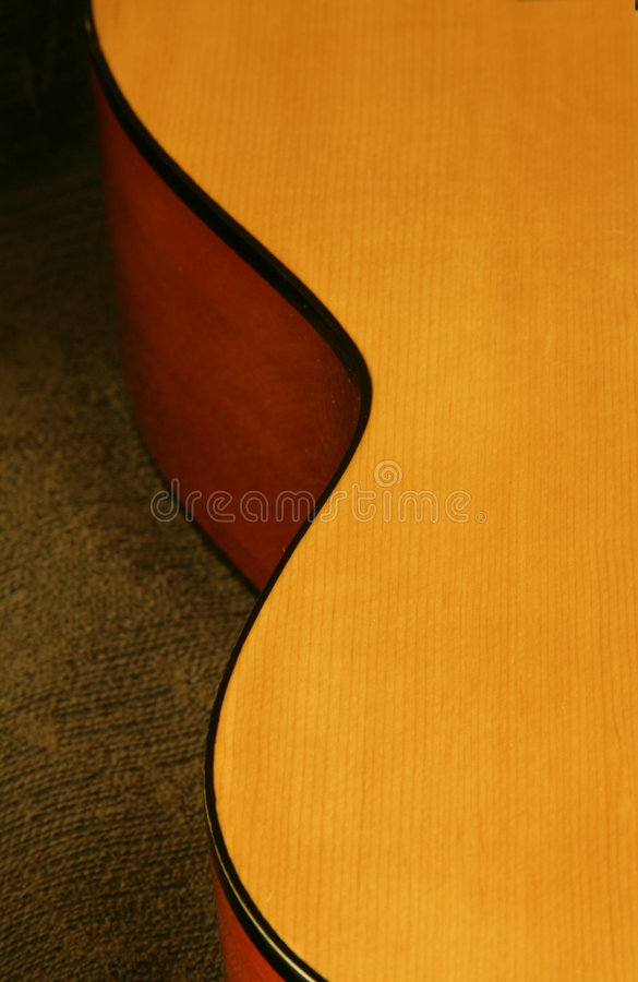 Classic guitar detail. Classic wooden guitar detail on textured background stock photos