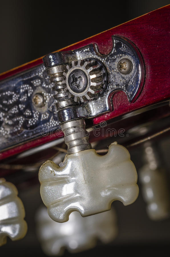 Classic guitar detail. Close up the tuning pegs of a classic guitar. music stock photography