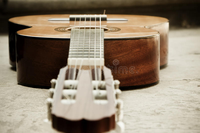 Classic guitar on the ground royalty free stock photos