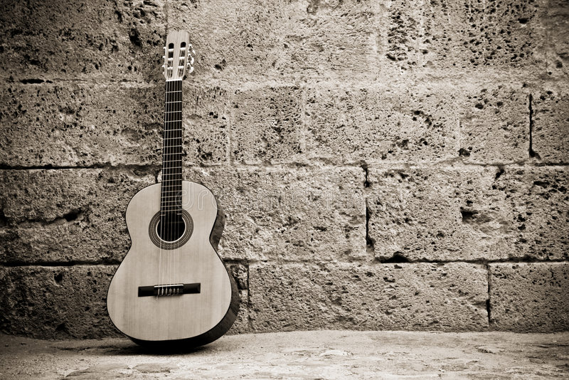Classic guitar on wall stock photo