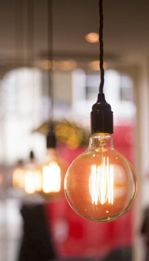 Classic hanging bulb stock image