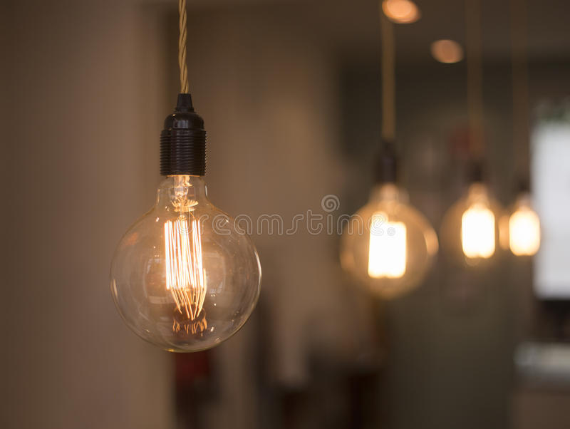 Classic hanging bulb queue royalty free stock photos