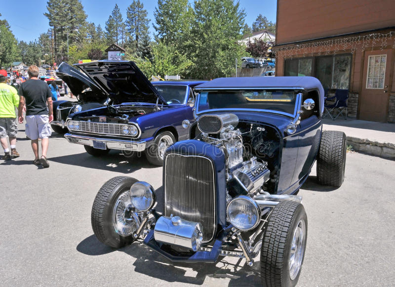 Classic High-Boy Roadster. This is a beautiful midnight blue highboy roadster with a matching convertible top. It is powered by a forced induction (blower) V-8 royalty free stock image