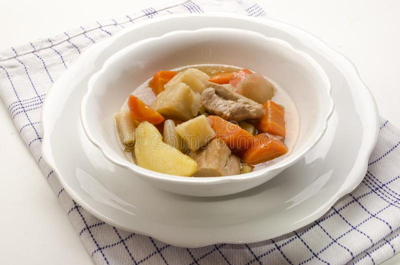 Delicious home made irish stew in a white bowl royalty free stock image