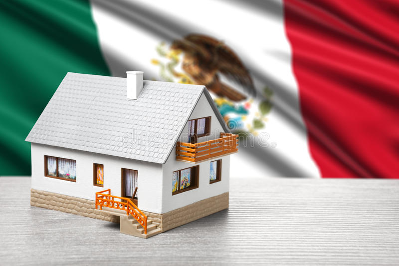 Classic house against Mexican flag. Background royalty free stock images