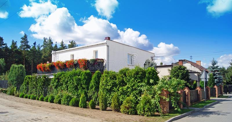 Classic House with flower garden royalty free stock photo