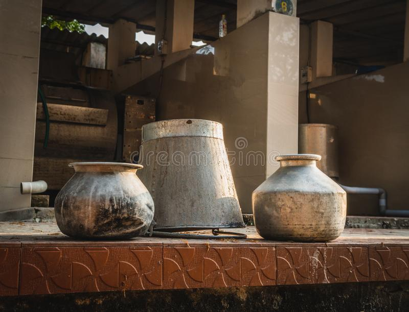 Classic indian pot for water at the sun in the royalty free stock images
