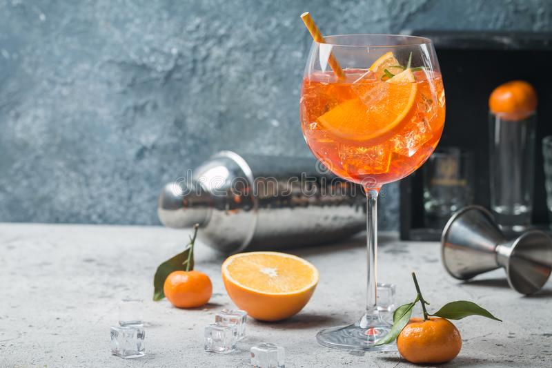 Aperol spritz cocktail. Classic Italian Aperol spritz cocktail in glass on gray background royalty free stock image