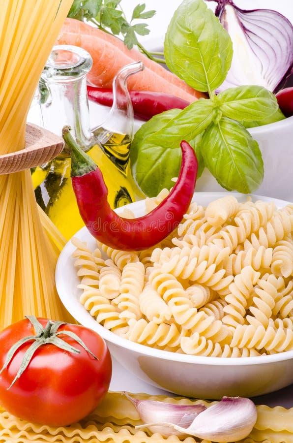 Classic Italian cuisine with spaghetti and fusilli stock images