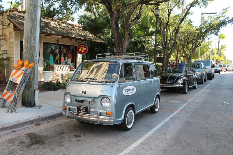 Classic old tiny Subaru minivan. Classic Japanese Kay car. Subaru Sambar micro van outdoors parked under the shade of trees. Coral Gables, Florida stock image