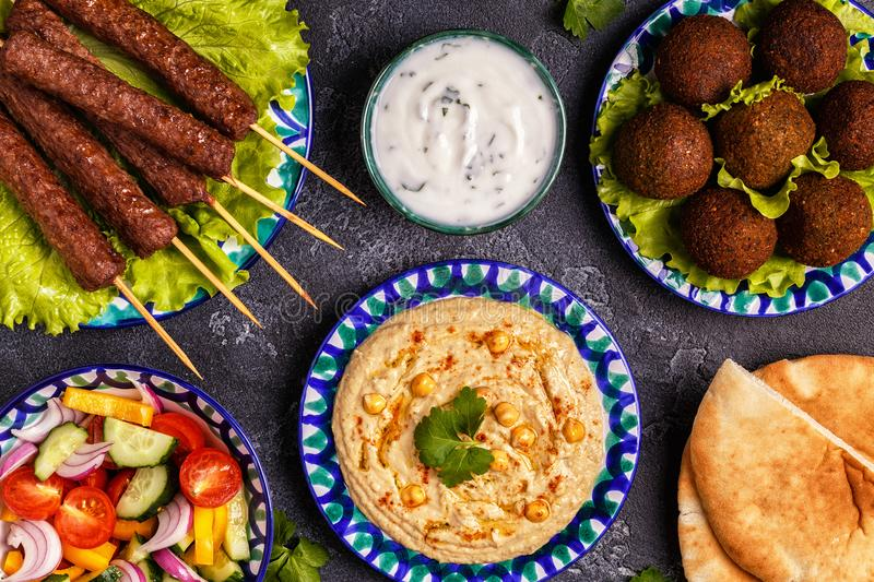 Classic kebabs, falafel and hummus on the plates. royalty free stock image