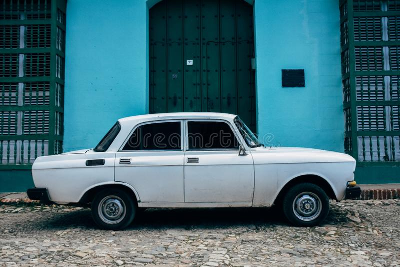 A classic Lada parked in Trinidad, Cuba. A classic white Lada is parked in the streets of Trinidad, Cuba stock photos