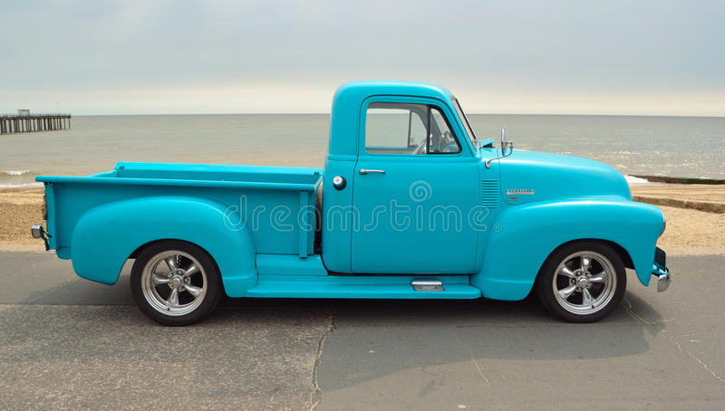 Classic Light Blue Chevrolet 3100 pickup truck on seafront promenade with sea in background royalty free stock photos