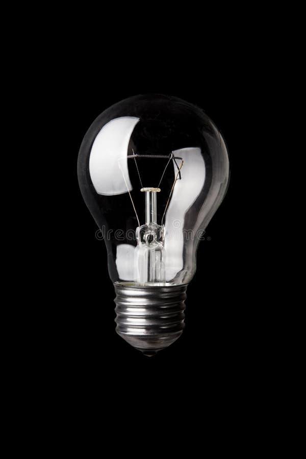 Classic Light Bulb On Black Royalty Free Stock Photos