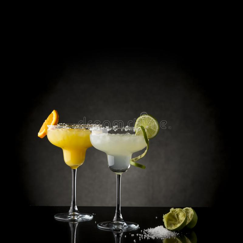 Lime and orange margarita cocktails royalty free stock photo