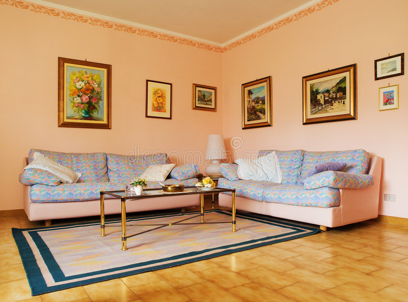 Classic living room. A classic living room with carpet, sofas and paintings. Delicate colors stock images