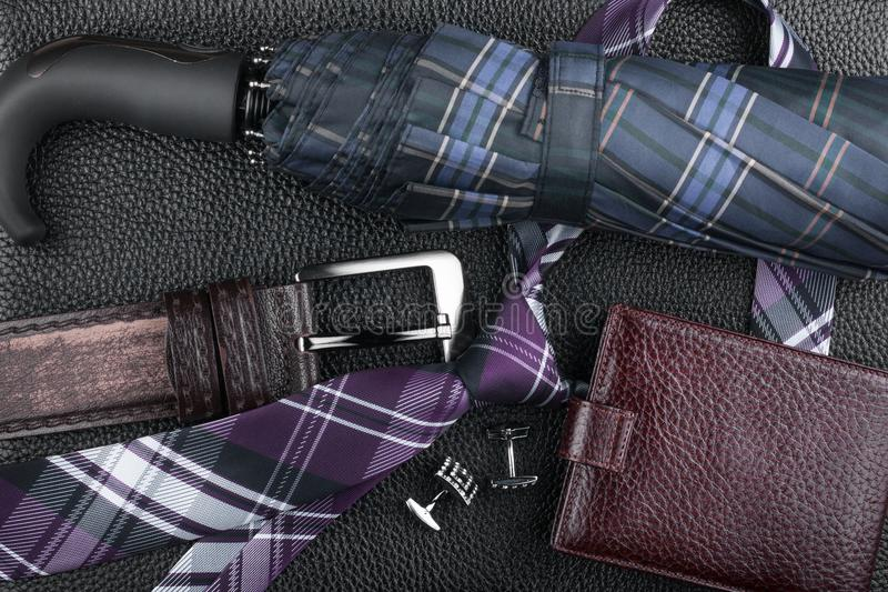 Classic luxury accessories lying on black natural leather. stock photo