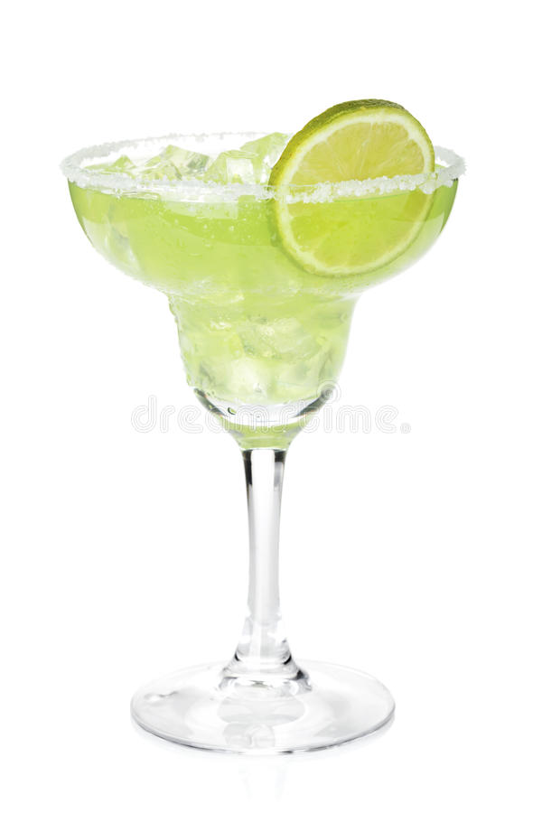 Classic margarita cocktail with lime slice and salty rim stock images