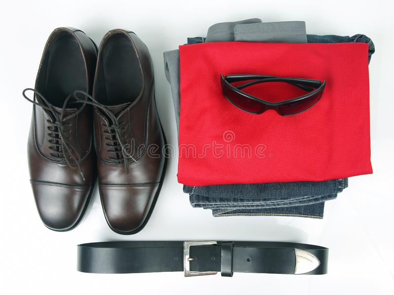 Classic men`s brown shoes, belt and clothes on white background. The Classic men`s brown shoes, belt and clothes on white background stock photo