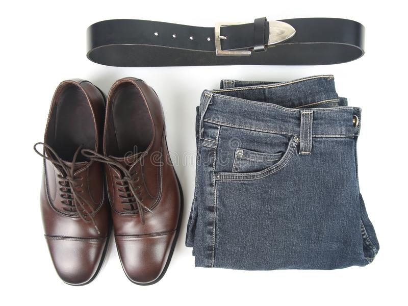 Classic men`s brown shoes, belt and clothes on white background. The Classic men`s brown shoes, belt and clothes on white background stock image