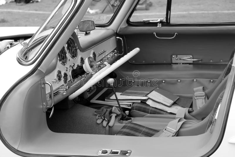 Classic mercedes super sports car cabin b&w. 1950s vintage german super sports car side view into cabin through open gullwing doors. 1955 Mercedes-benz 300sl royalty free stock photos