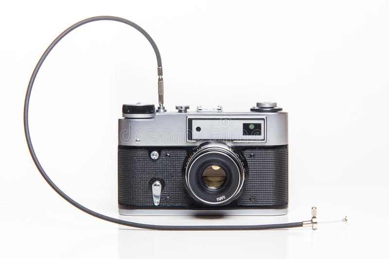 Classic 35mm old analog camera with cable release. Classic 35mm old analog camera on white - studio shoot royalty free stock photo