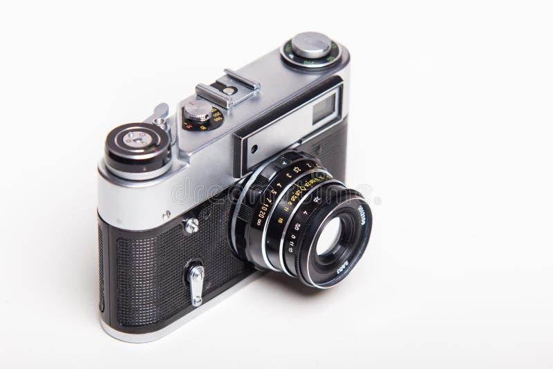 Classic 35mm old analog camera on white. Studio shoot royalty free stock photo