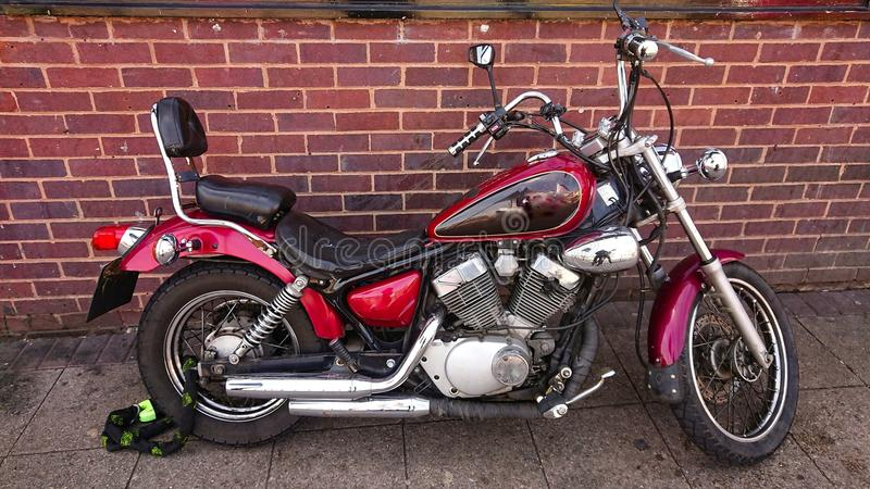 Red chrome classic motorbike. A classic motorbike with shining chrome royalty free stock photography