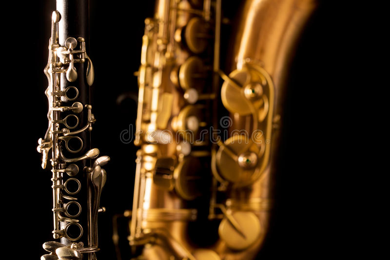 Classic music Sax tenor saxophone and clarinet in black. Background royalty free stock photos