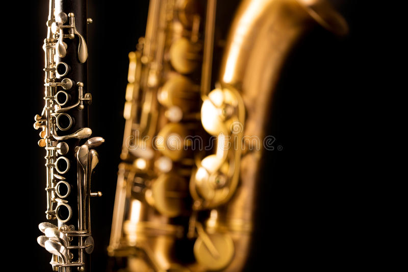 Classic music Sax tenor saxophone and clarinet in black. Background stock photos