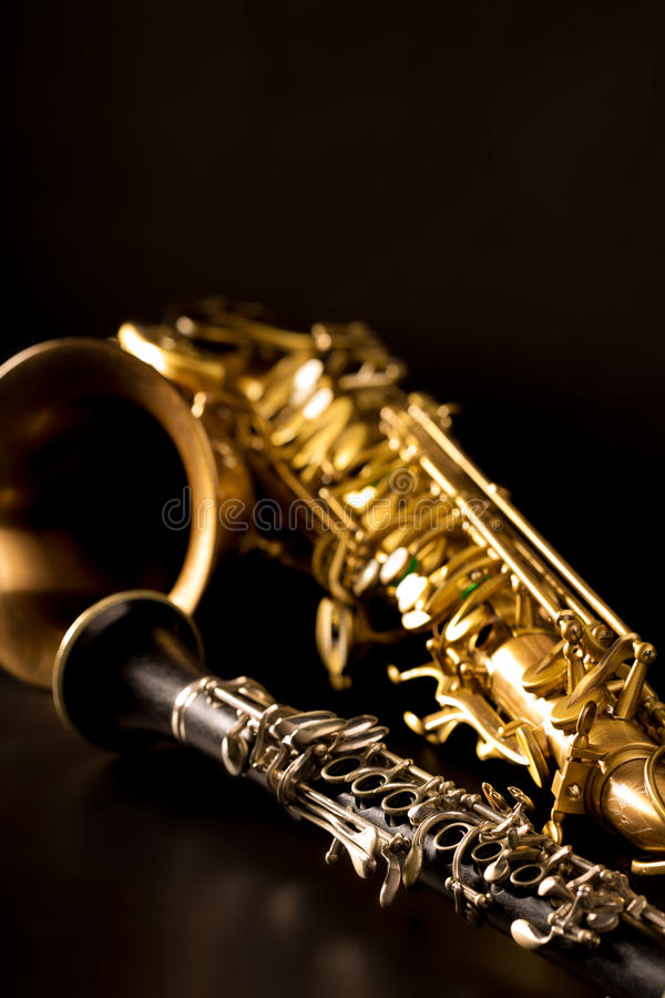 Classic music Sax tenor saxophone and clarinet in black. Background stock images
