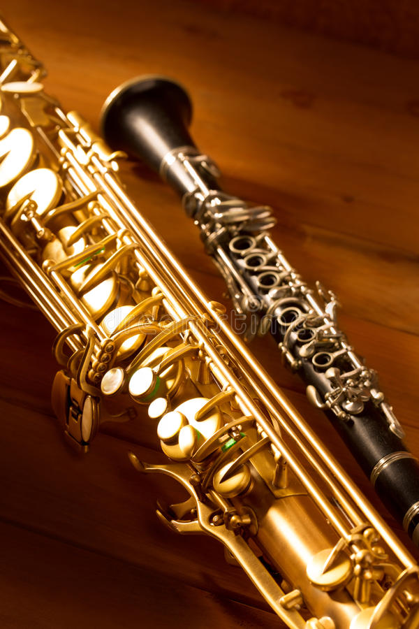 Classic music Sax tenor saxophone and clarinet vintage. Classic music Sax tenor saxophone and clarinet in vintage wood background royalty free stock photos