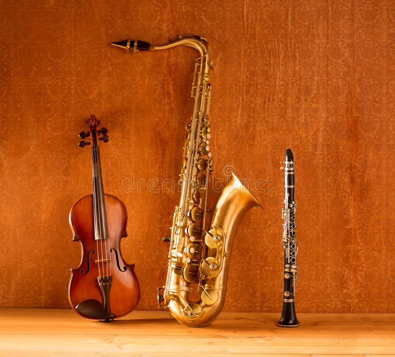 Classic music Sax tenor saxophone violin and clarinet vintage. Classic music Sax tenor saxophone violin and clarinet in vintage wood background stock photography