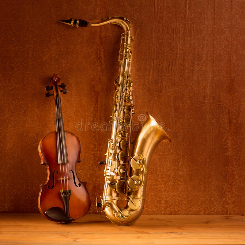 Classic music Sax tenor saxophone violin in vintage. Wood background stock photography